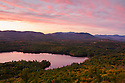 Pink sky augments autumns color in this view of Squam Lake.