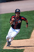 Rochester Red Wings catcher Eric Fryer (22) scores a run during a game against the Norfolk Tides on May 3, 2015 at Frontier Field in Rochester, New York.  Rochester defeated Norfolk 7-3.  (Mike Janes/Four Seam Images)