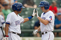 Round Rock Express outfielder Jarred Hoying (40) is greeted by teammate Guilder Rodriguez (1) after hitting a home run during the Pacific Coast League baseball game against the Salt Lake Bees on August 10, 2013 at the Dell Diamond in Round Rock, Texas. Round Rock defeated Salt Lake 9-6. (Andrew Woolley/Four Seam Images)