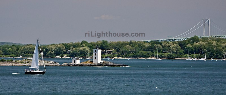 Sailors pass Dutch Island Lighthouse on their way out to sea.