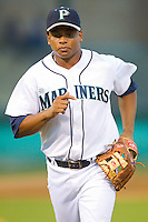 Third baseman Ramon Morla #22 of the Pulaski Mariners runs off the field between innings of the Appalachian League game against the Greeneville Astros at Calfee Park August 29, 2010, in Pulaski, Virginia.  Photo by Brian Westerholt / Four Seam Images