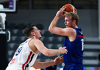22nd February 2021, Podgorica, Montenegro; Eurobasket International Basketball qualification for the 2022 European Championships, England versus France;  Dan Clark of Great Britain holds the ball away from Alexandre Chassang of France