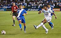 CARSON, CA – June 6, 2011: Honduran Carlo Costly (13) passes the ball during the match between Guatemala and Honduras at the Home Depot Center in Carson, California. Final score Guatemala 0, Honduras 0.