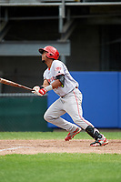 Greeneville Reds right fielder Reniel Ozuna (27) follows through on a swing during the first game of a doubleheader against the Princeton Rays on July 25, 2018 at Hunnicutt Field in Princeton, West Virginia.  Princeton defeated Greeneville 6-4.  (Mike Janes/Four Seam Images)