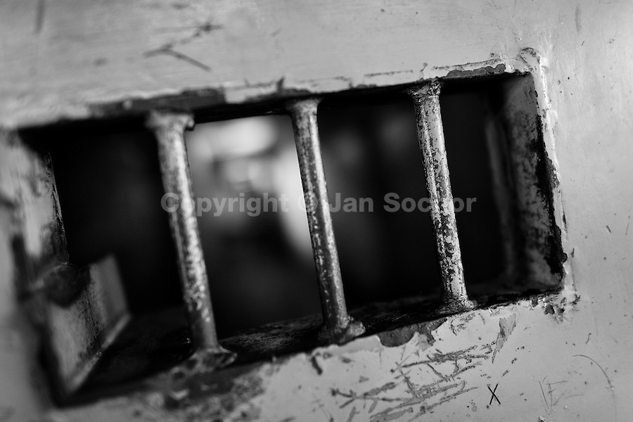 Bars of a cell in the prison for the Mara Salvatrucha gang members in Tonacatepeque, El Salvador, 18 May 2011. During the last two decades, Central America has become the deadliest region in the world that is not at war. According to the UN statistics, more people per capita were killed in El Salvador than in Iraq, in recent years. Due to the criminal activities of Mara Salvatrucha (MS-13) and 18th Street Gang (M-18), the two major street gangs in El Salvador, the country has fallen into the spiral of fear, violence and death. Thousands of Mara gang members, both on the streets or in the overcrowded prisons, organize and run extortions, distribution of drugs and kidnappings. Tattooed armed young men, mainly from the poorest neighborhoods, fight unmerciful turf battles with their coevals from the rival gang, balancing between life and death every day. Twenty years after the devastating civil war, a social war has paralyzed the nation of El Salvador.