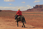 Navajo Indian riding black horse at John Ford Overlook, Monument Valley, Arizona, USA. . John offers private photo tours in Monument Valley and throughout Arizona, Utah and Colorado. Year-round.