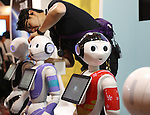 July 21, 2016, Tokyo, Japan - Japanese communication giant Softbank's humanoid robot Peppers are displayed for business use at Softbank's two-day convention Softbank World in Tokyo on Thursday, July 21, 2016. Softbank CEO Masayoshi Son delivered a keynote speech at the event after the company announced to acquire British chip maker ARM last week.     (Photo by Yoshio Tsunoda/AFLO) LWX -ytd-