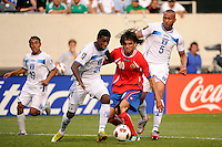 Juan Garcia (21) of Honduras and Bryan Ruiz (10) of Costa Rica. during a quarterfinal match of the 2011 CONCACAF Gold Cup at the New Meadowlands Stadium in East Rutherford, NJ, on June 18, 2011.