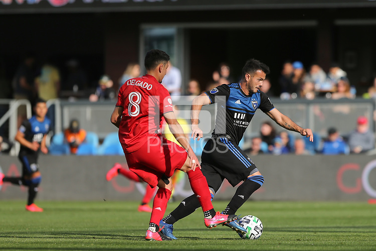 SAN JOSE, CA - FEBRUARY 29: Vako #11 of the San Jose Earthquakes is defended by Marky Delgado #8 of Toronto FC during a game between Toronto FC and San Jose Earthquakes at Earthquakes Stadium on February 29, 2020 in San Jose, California.