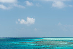 Mulak Kandu, Mulaku Atoll, Maldives; a view of the shallow coral reef and tropical blue water near the deep water pass between two islands