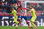 Yannick Ferreira Carrasco (L) of Atletico de Madrid is tackled by Sergio Mora Sanchez of Getafe CF during the La Liga 2017-18 match between Atletico de Madrid and Getafe CF at Wanda Metropolitano on January 06 2018 in Madrid, Spain. Photo by Diego Gonzalez / Power Sport Images