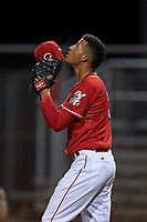 AZL Reds relief pitcher Dannysmel Tavarez (3) points to the sky after picking up the win after an Arizona League game against the AZL Athletics Green on July 21, 2019 at the Cincinnati Reds Spring Training Complex in Goodyear, Arizona. The AZL Reds defeated the AZL Athletics Green 8-6. (Zachary Lucy/Four Seam Images)