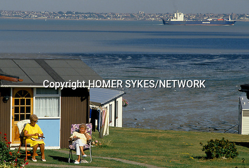 Static caravan holiday homes permanent camp site All Hallows on Sea Thames estuary mouth of the river east London 1991 1990s UK . People live here 8 months of the year.