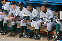 Tim Beckham (6) (center) watches the game with Princeton Rays teammates Brian Bryles (3) (left) and Burt Reynolds (17) at Burlington Athletic Park in Burlington, NC, Monday August 11, 2008. (Photo by Brian Westerholt / Four Seam Images)