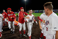 Auburn Doubledays Jake Alu (9) celebrates with teammates, including Trey Turner (left) after a game winning walk off single during a NY-Penn League game against the Mahoning Valley Scrappers on August 27, 2019 at Falcon Park in Auburn, New York.  Auburn defeated Mahoning Valley 3-2 in ten innings.  (Mike Janes/Four Seam Images)
