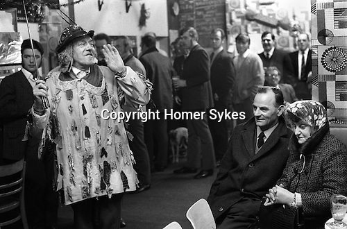 Eddie Hardcastle leader of the Ripon Sword Dance Play mummers performing in a pub in Ripon Boxing Day 1972.