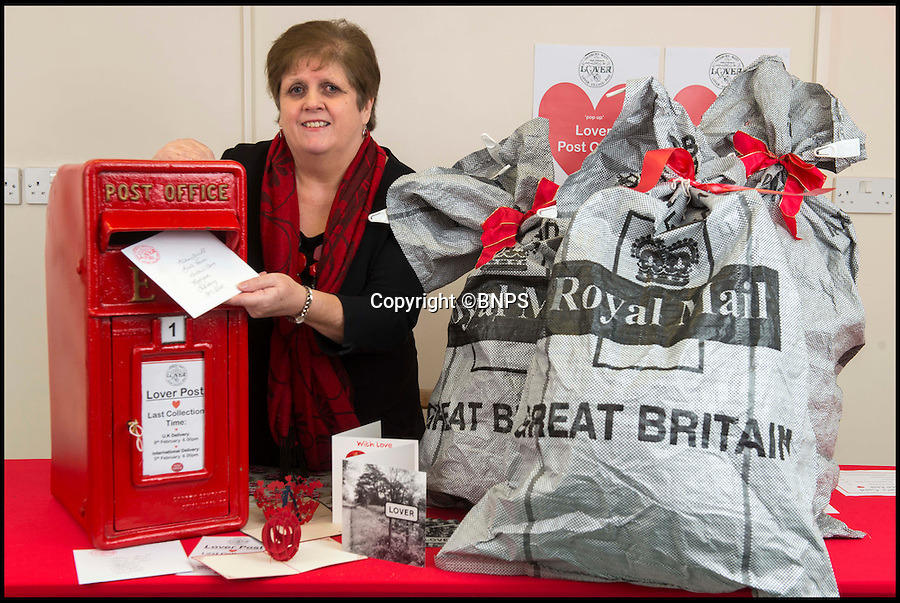 BNPS.co.uk (01202 558833)<br /> Pic: TomWren/BNPS<br /> <br /> Lynda Cooper who was the post mistress at eh old post office 30 years ago posts a Valentine's card at the pop-up post office.<br /> <br /> A British village is cashing in on the cupid effect this Valentine's Day by launching its own postal service so anyone can send a card from the 'world's most romantic village'.<br /> <br /> The tiny village of Lover in Wiltshire has launched the 'Lover Post' with limited edition cards and a special post mark showing it has been sent from the tender-hearted village.<br /> <br /> The quirky gimmick is part of a campaign to save the once-thriving village for the local community.