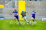 Shane Nolan on the run in possession as his lost his hurley as Stephen Leen races towards him, in the County Senior Hurling Championship quarter final