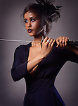 Beautiful black woman with a veil holding a katana sword in her hands Image © MaximImages, License at https://www.maximimages.com