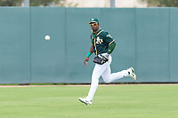 Oakland Athletics left fielder Lazaro Armenteros (13) prepares to field a ball during an exhibition game against Team Italy at Lew Wolff Training Complex on October 3, 2018 in Mesa, Arizona. (Zachary Lucy/Four Seam Images)
