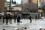 SULAIMANIYAH, IRAQ:  Kurdish security forces throw stones back at protesters during clashes...Tension continues to grow in the semi-autonomous region of Iraqi Kurdistan as protesters clash with police on a 5th day of unrest...Photo by Haedar Omar