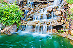 Man made water feature, Moment in Time Falls, Ohme Gardens, Wenatchee, Chelan County, Washington, USA.  Man made waterfall.
