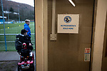 Spectators waiting for the tea room to open before Cambrian and Clydach Vale take on Cwmbran Celtic at King George's New Field in a Welsh League Division One match, the top division of the Welsh Football League and the second level of the Welsh football league system. The club, formed in 1965 reached the final of the 2018-19 League Cup final and can count on ex-England manager Terry Venables as a former club chairman. Cambrian and Clydach Vale won this match 2-0, watch by a crowd of around 100 spectators.