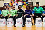 "WATERBURY, CT- 20 November 2014-112014EC03--   Alexus Lowe, Alana Johnson, Alexiandria Richards, Raja Crawford and Raj Rambin (L to R) play ""Bucket Bash,"" a drum performance, as part of the Fall Showcase from members of the Waterbury Symphony's Bravo Waterbury! music program. Hundreds came out to hear the concert in Sacred Heart's gymnasium Thursday night. Erin Covey Republican-American"