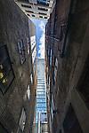 Looking up between the buildings on Temperance Lane, Sydney, NSW, Australia
