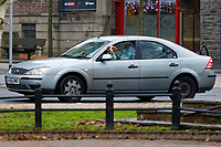 A dog with his head out of a silver Ford Focus car in Merthyr Tydfil, south Wales, UK. Wednesday 12 December 2018
