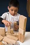 Education preschool 4 year olds block area boy building with wooden blocks vertical