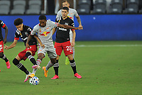 WASHINGTON, DC - SEPTEMBER 12: Kevin Paredes #30 of D.C. United battles for the ball with Kyle Duncan #6 of New York Red Bulls during a game between New York Red Bulls and D.C. United at Audi Field on September 12, 2020 in Washington, DC.