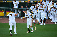 Bradenton Marauders Hudson Head (17) congratulates Abrahan Gutierrez (27) after a home run during Game Two of the Low-A Southeast Championship Series against the Tampa Tarpons on September 22, 2021 at LECOM Park in Bradenton, Florida.  (Mike Janes/Four Seam Images)