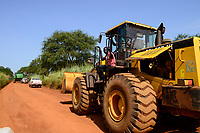 ETHIOPIA, Gambela, Abobo, the government give large land for cheap lease to domestic and foreign investors, after deforestation the investors cultivate large farm lands with food crop for export, local people are often settled under villagization programs, John Deere combine harvester of Saudi Star Agricultural Development PLC is shifted on narrow road for the rice harvest , Saudi Star owned by Saudi-Ethiopian billionaire Sheikh Mohamed al-Amoudi has a rice farm of about 10.000 hectares along the Alwero river / AETHIOPIEN, Gambela, Abobo, die aethiopische Regierung verpachtet grosse Landflaechen an Investoren fuer den Anbau von Nahrungsmitteln fuer den Export, Umsiedlung der lokalen Bevoelkerung fuehrt zu Konflikten, ein John Deere Maehdrescher des Investors Saudi-Star wird zur Reisernte gefahren