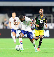 DALLAS, TX - JULY 25: Shaq Moore #20 of the United States brings the ball up the field during a game between Jamaica and USMNT at AT&T Stadium on July 25, 2021 in Dallas, Texas.