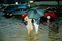 July 14, 1987 File Photo - Montreal (Qc) CANADA  -  Cars and people during One of montreal worst flood.<br /> <br /> The Montreal Flood of 1987 happened on July 14 of that year when a series of strong thunderstorms crossed the island of Montreal, Canada, between the noon hour and 2:30 p.m. Over 100 mm of rain fell during this very short period of time. The sewer systems were overwhelmed by the deluge and the city was paralyzed by the flooded roads. Autoroute 15, a sunken highway also known as the Decarie Expressway, soon filled with water trapping motorists. Some 350,000 houses lost electricity, and tens of thousands had flooded basements. Two people died, one in a submerged car and another who was electrocuted