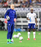DALLAS, TX - JULY 25: Brad Guzan #22 of the United States watches his teammates warm up before a game between Jamaica and USMNT at AT&T Stadium on July 25, 2021 in Dallas, Texas.