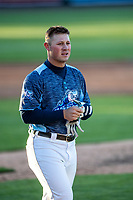 West Michigan Whitecaps third baseman Spencer Torkelson (8) in action against the Great Lakes Loons at LMCU Ballpark on May 11, 2021 in Comstock Park, Michigan. The Loons defeated the Whitecaps in their home opener 9-1. (Andrew Woolley/Four Seam Images)