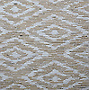 Femi, a hand cut stone mosaic, shown in tumbled Jura Grey and Carrara.