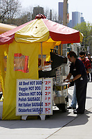 Toronto (ON) CANADA,  April , 2008-..A man stop at a hot dog stand beside the.Royal Ontario Museum...The Royal Ontario Museum, commonly known as the ROM, is a major museum for world culture and natural history in the city of Toronto, Ontario, Canada. The ROM is the fifth largest museum in North America, containing more than six million items and over 40 galleries. It is also the largest museum in Canada. It has notable collections of dinosaurs, Near Eastern and African art, East Asian art, European history, and Canadian history. It has also hosted many travelling exhibits...The museum is located at the corner of Bloor Street and Avenue Road, north of Queen's Park ..