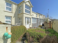 BNPS.co.uk (01202) 558833. <br /> Pic: LillicrapChilcott/BNPS<br /> <br /> Room with a view...<br /> <br /> A former fisherman's cottage a stone's throw from the beach with incredible far-reaching ocean views is on the market for offers over £600,000.<br /> <br /> One bedroom has a particularly impressive outlook with windows looking over the water in three directions.<br /> <br /> Salt Spray, which is in Porthleven, Cornwall, is being sold as part of a deceased's estate and it is only the second time it has been on the open market.