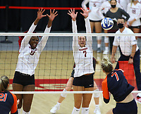 Auburn Junior Rebekah Rath (7) hits the ball over the net against Abigail Archibong (9) and Taylor Head (7) on Sunday, Oct. 10, 2021, during play at Barnhill Arena, Fayetteville. Visit nwaonline.com/211011Daily/ for today's photo gallery.<br /> (Special to the NWA Democrat-Gazette/David Beach)