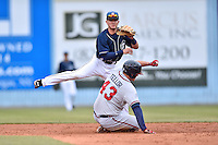 Asheville Tourists second baseman Forrest Wall (7) makes the turn on a double play over a hard sliding Matt Tellor (43) during a game against the Rome Braves on May 16, 2015 in Asheville, North Carolina. The Braves defeated the Tourists 6-3. (Tony Farlow/Four Seam Images)