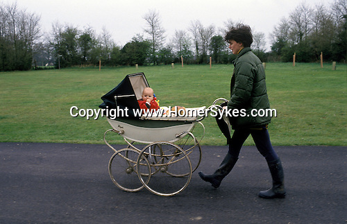 Dame Elizabeth Marvyn Charity. Ufton Court, Near Ufton Nervet, Berkshire, England. Local woman leaves with loaf of bread.