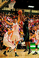 13 February 2011: University of Vermont Catamount forward Evan Fjeld, a Senior from Durham, NC, defends against Binghamton University Bearcat forward Greer Wright, a Senior from  Boynton Beach, FL, at Patrick Gymnasium in Burlington, Vermont. The Catamounts came from behind to defeat the Bearcats 60-51 in their America East matchup. The Cats took part in the National Pink Zone Breast Cancer Awareness Program by wearing special white jerseys with pink trim. The jerseys were auctioned off following the game with proceeds going to the Vermont Cancer Center. Mandatory Credit: Ed Wolfstein Photo