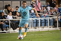 SAN JOSE, CA - AUGUST 17: Ethan Finlay #13 of Minnesota United dribbles the ball during a game between San Jose Earthquakes and Minnesota United FC at PayPal Park on August 17, 2021 in San Jose, California.