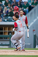 Joe Dunand (10) of the North Carolina State Wolfpack knocks helmets with teammate Joel McKeithan (5) after hitting a home run against the Charlotte 49ers at BB&T Ballpark on March 31, 2015 in Charlotte, North Carolina.  The Wolfpack defeated the 49ers 10-6.  (Brian Westerholt/Four Seam Images)