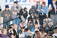 People crowd to the front of the room to greet Texas senator and Republican presidential candidate Ted Cruz after he spoke during a town hall event at Peterborough Town House in Peterborough, New Hampshire, on Sun., Feb. 7, 2016. Seen in the picture on stage are photographers Jason Eskenazi, Allegra Boverman, Spencer Platt, Ryan McBride, and Eric Thayer, among others.