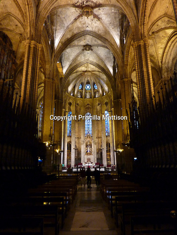 Barcelona, Spain - January 30, 2011:  A view to the altar shows the golden ceilings in the Catedral de Barcelona.