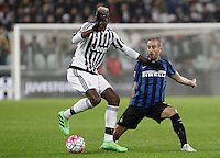 Calcio, Serie A: Juventus vs Inter. Torino, Juventus Stadium, 28 February 2016.<br /> Juventus' Paul Pogba, left, is challenged by Inter's Rodrigo Palacio during the Italian Serie A football match between Juventus and Inter at Turin's Juventus Stadium, 28 February 2016.<br /> UPDATE IMAGES PRESS/Isabella Bonotto